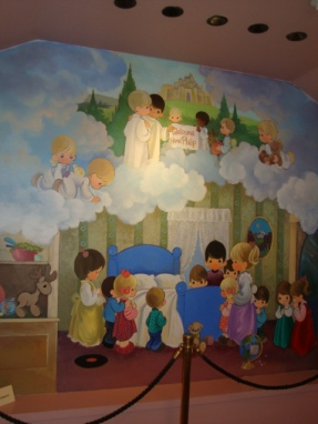 "At the Precious Moments Chapel in Carthage, Mo., artist Sam Butcher painted this mural in a room dedicated to his son, Philip, who died in a car accident. The sign in heaven reads ""Welcome home, Philip."""