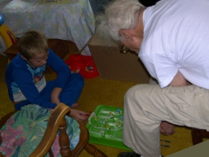 A year before my parents moved to Jefferson to live near us, we visited them in Pittsburgh. Here, Dad and Tim play a tabletop hockey game.